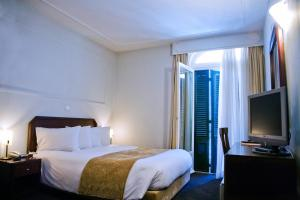 A bed or beds in a room at Arni Hotel Domotel
