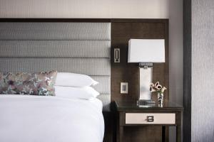 A bed or beds in a room at The Ritz-Carlton Atlanta
