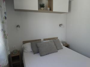 A bed or beds in a room at Camping El Torres