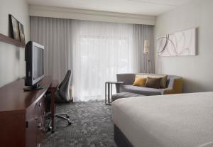 A television and/or entertainment center at Courtyard by Marriott Boston Norwood/Canton