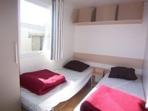 Een bed of bedden in een kamer bij Park Kerlinga