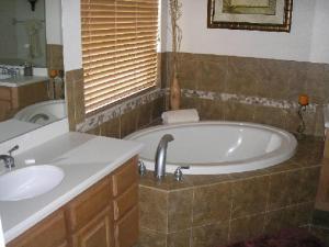 A bathroom at Mediterranean 4 Bedroom 3 Bath Pool Home Near Disney