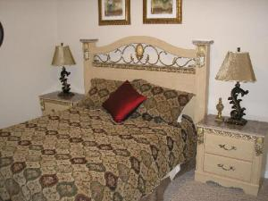 A bed or beds in a room at Mediterranean 4 Bedroom 3 Bath Pool Home Near Disney