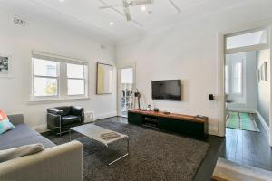 A seating area at Jacques Avenue - A Bondi Beach Holiday Home