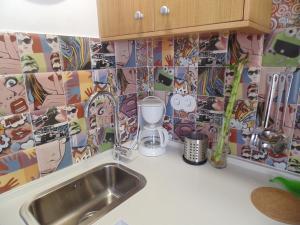 Una cocina o zona de cocina en Apartamentos 14DeSande