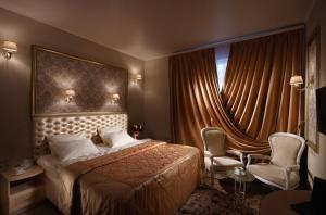 Кровать или кровати в номере Крошка Енот на Волоколамском