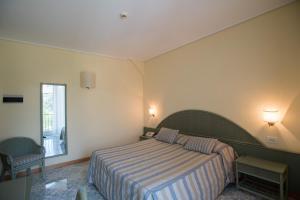 Letto o letti in una camera di Hotel Villa Maria