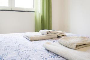 Uma cama ou camas num quarto em Pink House 2