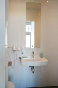 Een badkamer bij Hotel XL