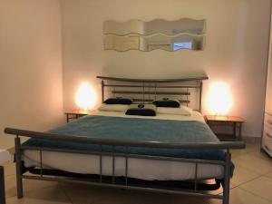 Un ou plusieurs lits dans un hébergement de l'établissement La Résidence du Cap