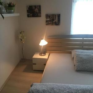 Postel nebo postele na pokoji v ubytování Apartment Pod Kotnovem