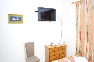 A television and/or entertainment center at The Dharma Lodge