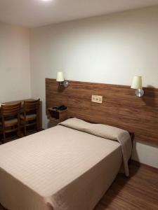Cama ou camas em um quarto em Hotel Globo Rio
