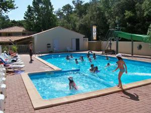 The swimming pool at or near Camping Le Clos Des Pins