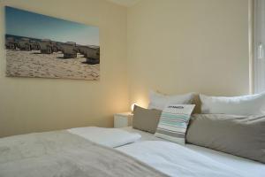 Ein Bett oder Betten in einem Zimmer der Unterkunft  Ferienappartement Mönchgut 14