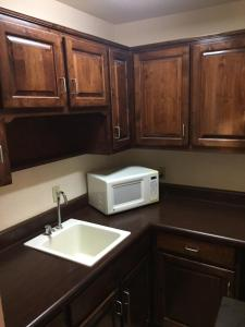 A kitchen or kitchenette at Haven Inn & Suites
