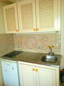 A kitchen or kitchenette at Marina Quality Stay Guadeloupe
