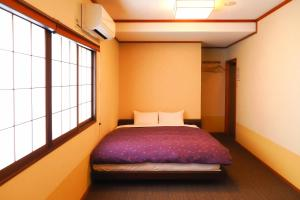 A bed or beds in a room at K's House Takayama Oasis [2nd K's Hostel]