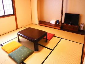 A seating area at K's House Takayama Oasis [2nd K's Hostel]