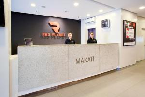 The lobby or reception area at Red Planet Manila Makati