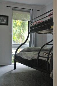 A bunk bed or bunk beds in a room at Mignon Cottage 9 Noongah Terrace