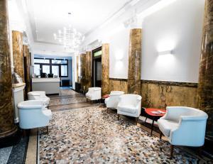 A bathroom at Green Class Hotel Astoria