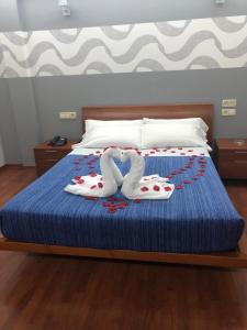 A bed or beds in a room at Motel Abalo