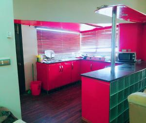 A kitchen or kitchenette at Khudadad Heights