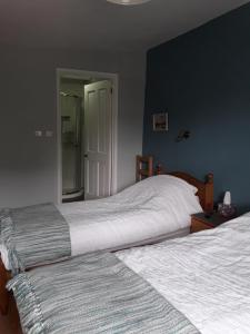 A bed or beds in a room at 6 Bridge St.