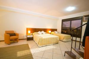 A bed or beds in a room at Edifício Metropolis