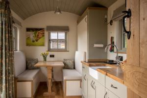 A kitchen or kitchenette at Luxury Shepherds Hut