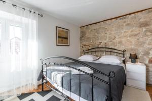 A bed or beds in a room at Holiday Home Riva Promenade