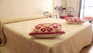 Letto o letti in una camera di Cagliari Affittacamere Castello