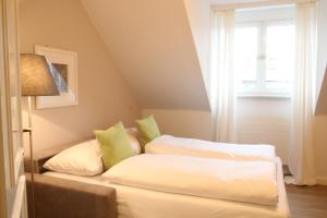 Ein Bett oder Betten in einem Zimmer der Unterkunft The Little Guesthouse