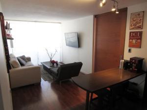 A seating area at El Cosmopolita Apartment