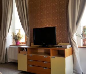 TV a/nebo společenská místnost v ubytování Hotel Merlot