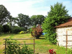 A garden outside Cozy Holiday Home in Marsac France with Swimming Pool