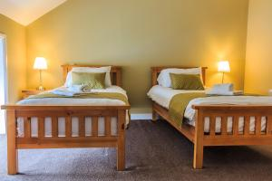 A bed or beds in a room at The Bridge Tavern