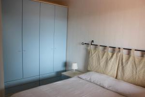 A bed or beds in a room at I Tramonti Apartments
