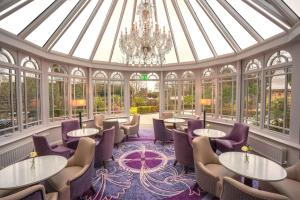 A restaurant or other place to eat at Tullyglass House Hotel