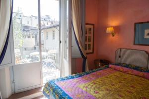 A bed or beds in a room at Antica Dimora Firenze
