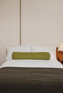 A bed or beds in a room at Triple J Hotel