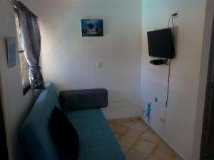 A television and/or entertainment center at Apartment in Sosua Center