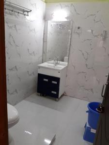 A bathroom at Joshi Holidays Home Stay