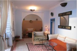 Zona de estar de Hôtel Ras El Maa