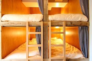 A bunk bed or bunk beds in a room at Koru Takanawa Gateway Hostel, Cafe&Bar