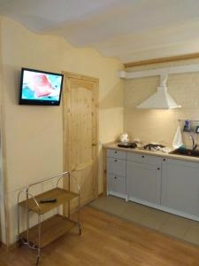 A kitchen or kitchenette at Apartment-studio on Ryleeva 15