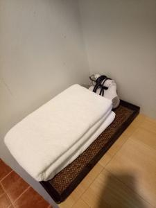 A bed or beds in a room at Baan Jaru