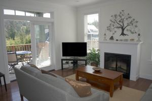 A television and/or entertainment center at Seaside Haven Three-Bedroom Home