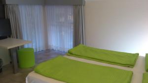 A bed or beds in a room at Hotel Toresela Bike am Gardasee